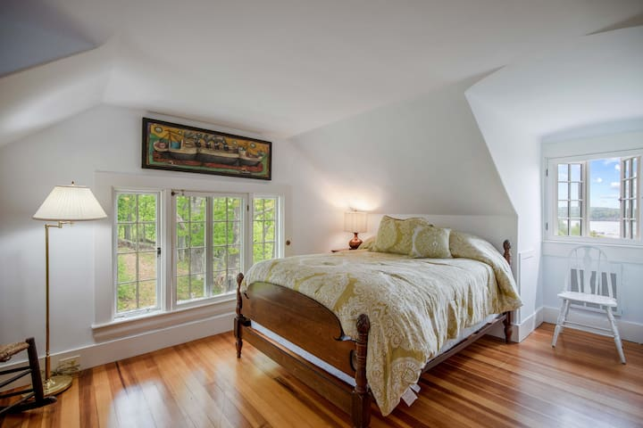 Queen size bed with shared bath on third floor