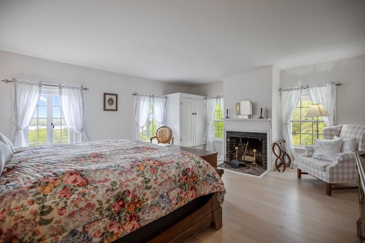 Queen size bed with fireplace, private bath on second floor