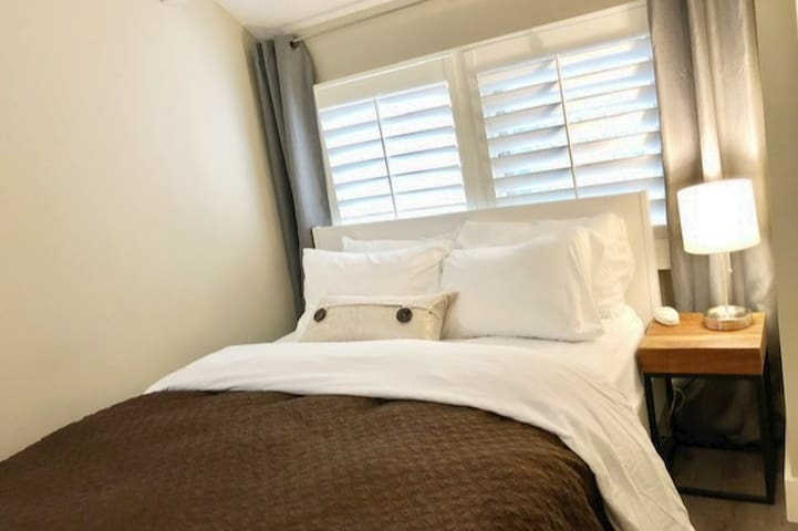 The first floor guest room has a queen bed, flat screen TV and plenty of storage.