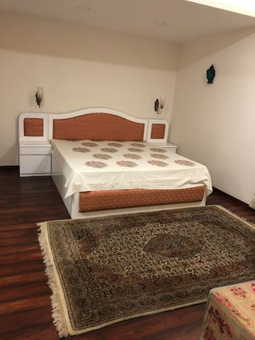 Bedroom 3: Has an attached bathroom and built-in closets. It has wooden flooring.