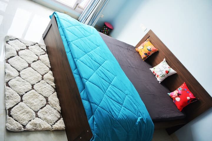 King size bed with colourful cushions to enjoy and relax during the day