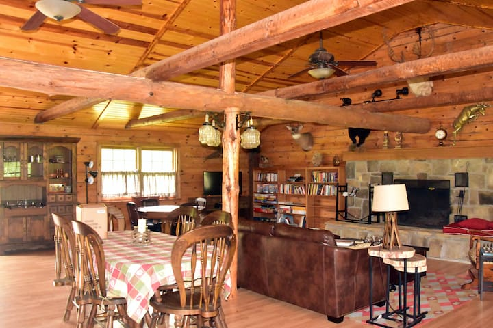 The main room has a fireplace and many cozy corners to sit, play games, and relax.  The cabin has internet and Roku tv but connectivity can be spotty since it's a remote area.  What better reason to unplug and enjoy life while you are visiting!!