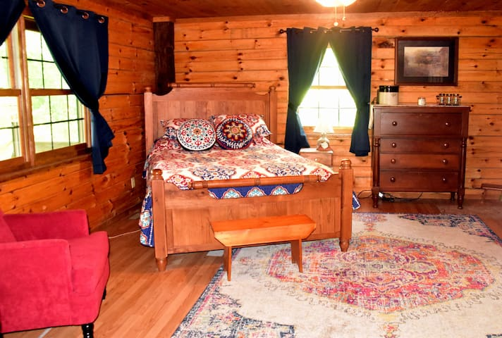 Bedroom has a queen bed with an adjoining bathroom with shower.  There are two armoires with extra blankets and room for guest to put their belonging so they feel at home.