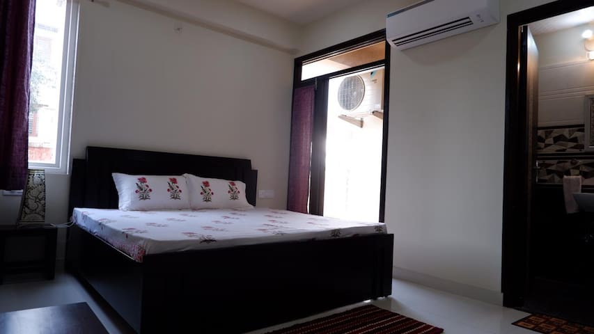 Bedroom 1 with balcony and attached bath