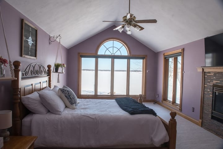 Master bedroom comes with stunning views of the lake, as well as smart tv for all your netflix binge watching