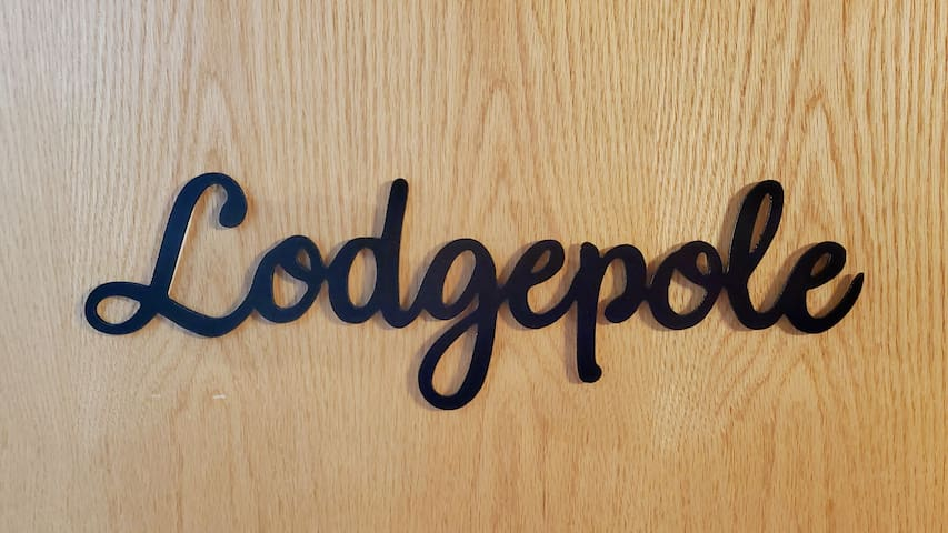 Lodgepole room on lower level can be booked with the 7-bedroom option for longterm rentals, or substituted for the Jack Pine room for the 6-bedroom option. It has 2x twin/full bunks, sleeper ottoman, ensuite with shower.