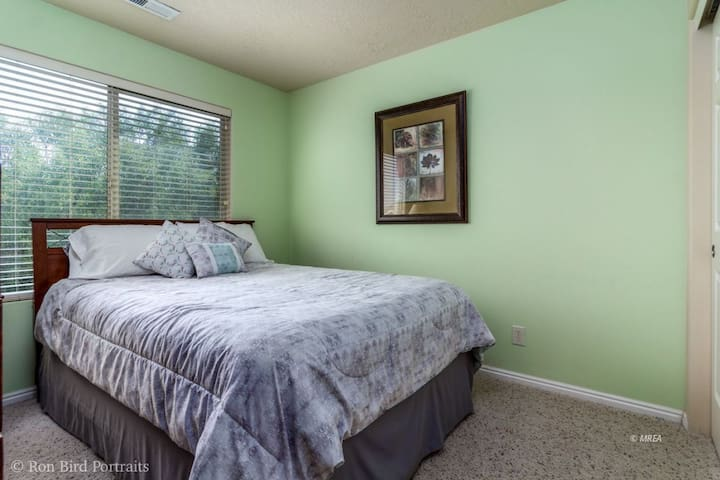 The first guest room is beautifully painted and cheerful.  The queen bed sleeps 2.