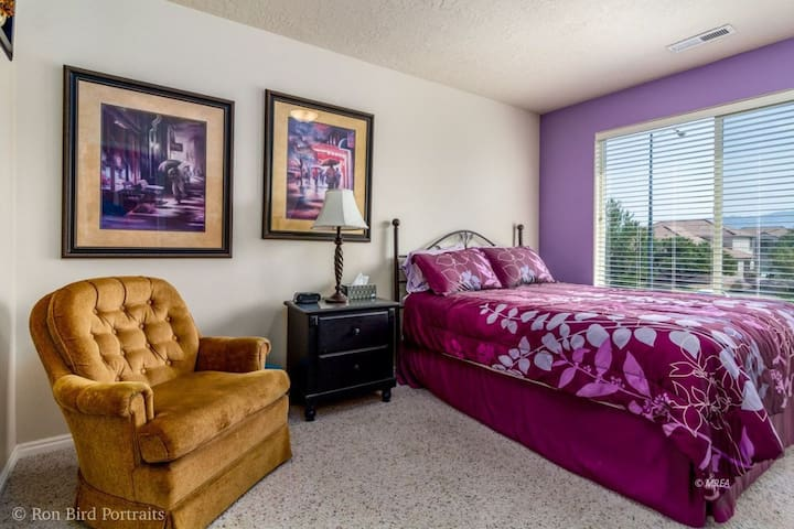 The second guest bedroom has a comfortable queen bed and is large enough for a chair and sitting area to read or watch TV.