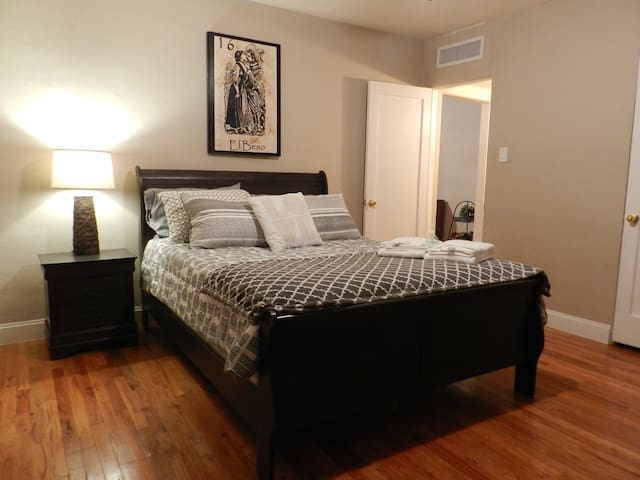 Master bedroom with smart TV to connect your streaming service. Large closet and drawers for you to unpack and enjoy your stay.