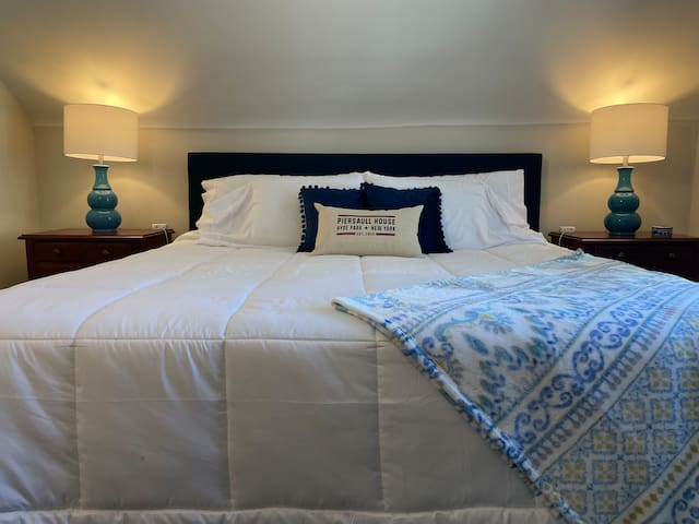The spacious master includes a king size bed.