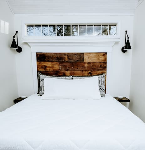 Queen size bed with reading lights,  night tables and USB charging station under each table