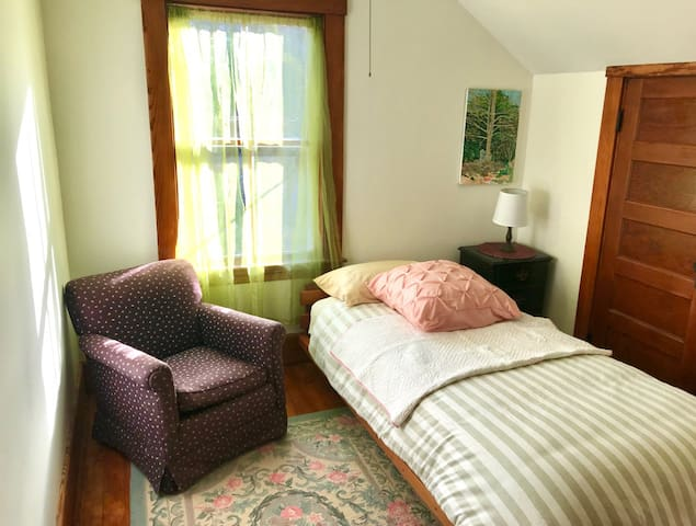 Bedroom 3,  extra long twin bed, morning light, Large closet... We can add a portable baby bed upon request.