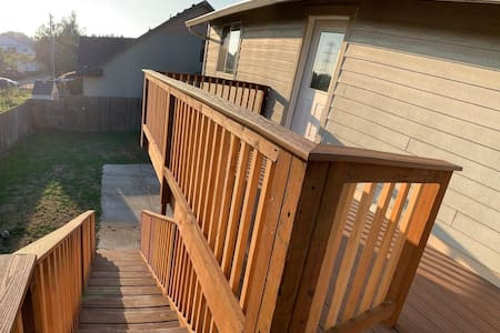 View: Deck, accesses Private Entryway, looking down stairs towards the lit all way/path from the street in front of house where you will conveniently park.