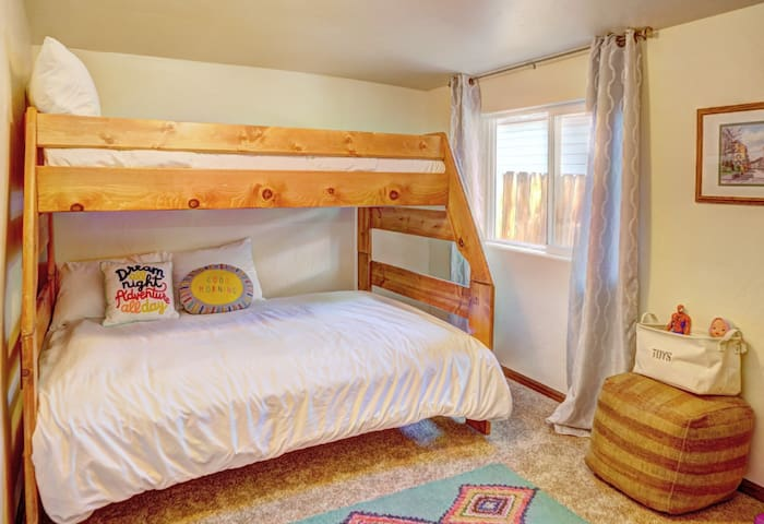 Right across from The Flower Room, The kid's room boasts a bunk bed with a Twin bed on top, Full bed for two on bottom, and a playpen for the littlest ones. The bathroom is right next door.