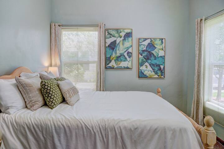 The Plant Room boasts a comfy Queen size bed and lots of sunshine on the first floor.
