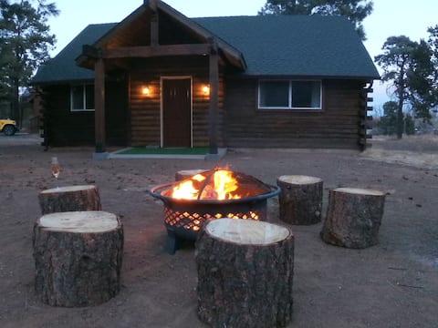 Romantic mountain log cabin close to town