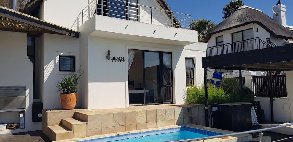 Entrance of flatlet overlooking pool and undercover jacuzzi