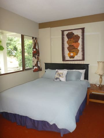 Cosy bedroom off your lounge with queen bed