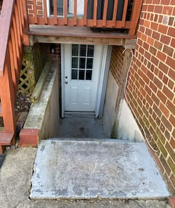 The private entrance is in the back of the house near the parking spot. There are automatic lights at night.