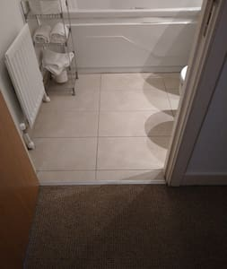 no stairs to bathroom for wheelchairs. wheelchair accessible. However you have to step over bath to get into the shower. Shower can be handheld