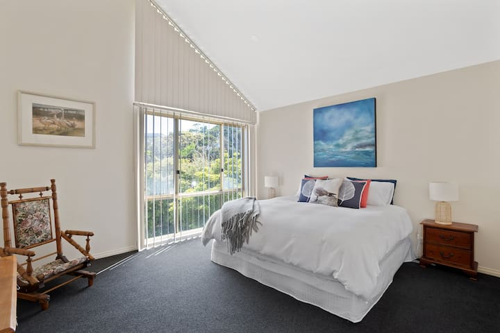 Beautifully decorated bedroom, full of natural light