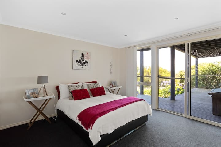 Queen bedroom with a garden view
