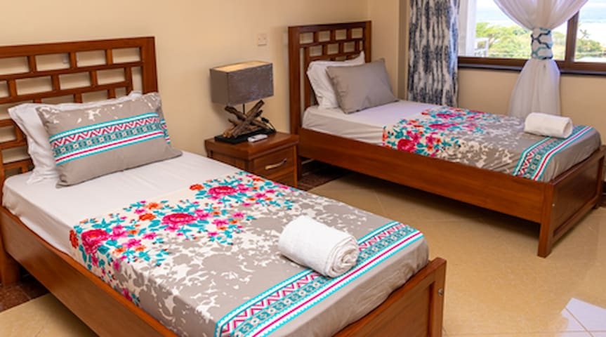 spacious beds with modern fixtures, A/C and large windows