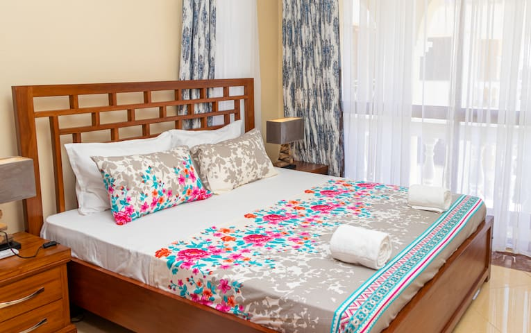 large king size bed with state of the art fixtures and wide windows