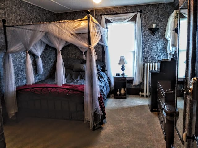 Castle-themed bedroom upstairs includes a queen canopy bed