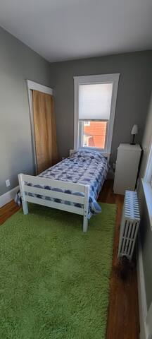 Twin bedroom with a balcony