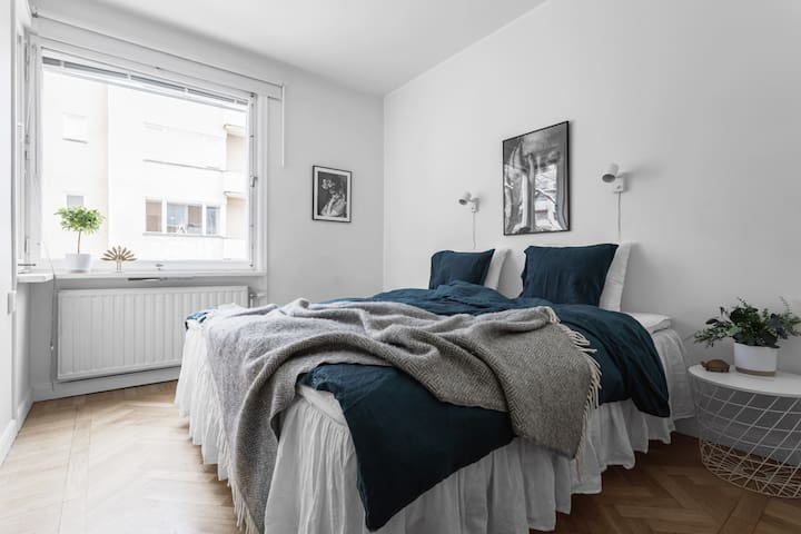 Bedroom one - spacious and fresh with a comfortable 180 cm double bed.