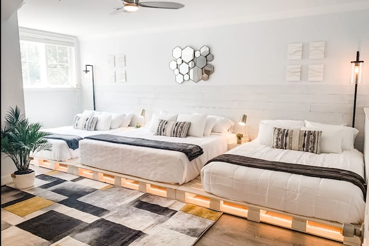 Beautiful, large sleeping loft!  3 custom built pallet beds - King and 2 Queens.  Great for kids, teens, or family. 44 inch Smart TV and refreshment nook