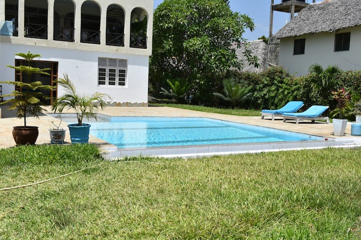 Spacious apartment with private garden and pool.