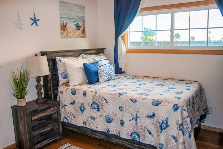 Coastal-themed private bedroom is perfect retreat!