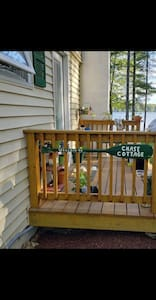 This is the side entrance, which you will use as our guests.  Looking at the house it is on the right. There are two steps to get up on to the deck and then one little step through the threshold... there is a 4 numeral key code on the door to enter.