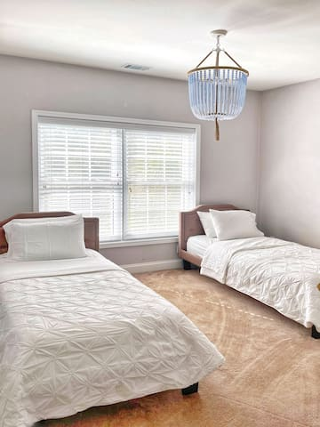 Twin beds with private bathroom attached