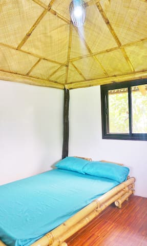 CABANA HUT: A simple, cozy, yet elegantly designed hut for your nature glamping experience. Maximum room occupancy is 4 persons, with an extra floor mattress.