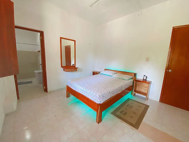 Master Room: enjoy a quality memory-foam mattress, smart TV, air conditioner, overhead Fan and private bathroom. Tastefully decorated to create a restful environment