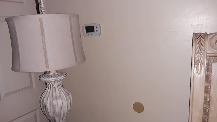 thermostat in bedroom, near lamp