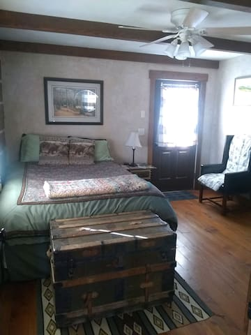 West bedroom features log wall and view of Absaroka Mountain range.  Queen size bed.