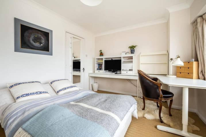 Lovely double bedroom with masses of storage and a desk looking out over expansive views