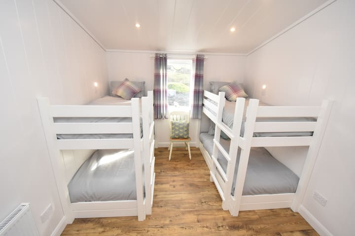 Heather room with 4 full size bunkbeds with views over farm land to Balgownie Woods