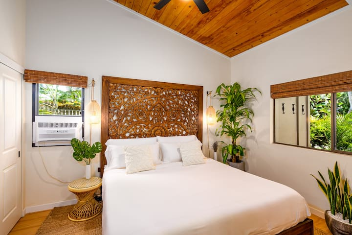 Primary bedroom with high ceilings, jungle views, handmade furniture and Bali vibes