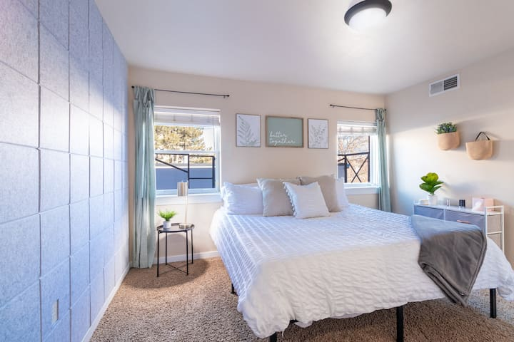 Rest and relax in the king sized! Large bedroom with cute designs and views out the windows of the cathedral and mountains.