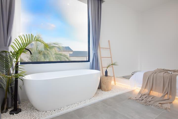 栖山民宿|三亚(亚龙湾|近玫瑰谷.热带雨林森林公园.庭院带泳池)沐光椰树浴缸大床房