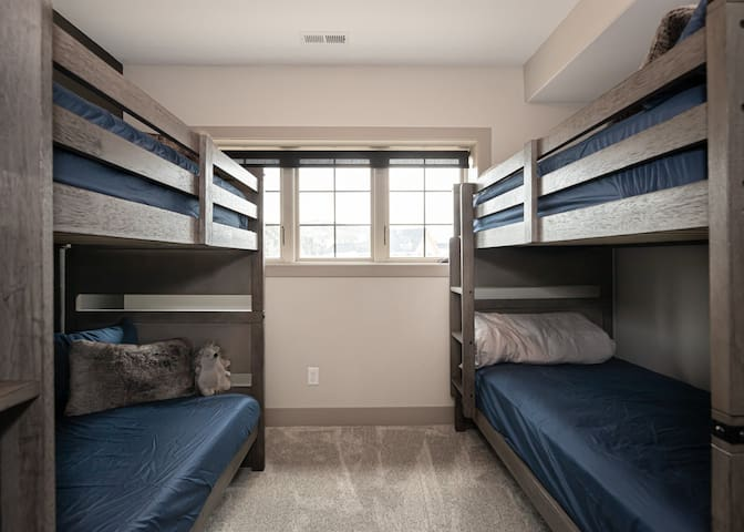The bunk room is cozy, and includes two twin over twin bunk beds, which can sleep up to 4 guests.