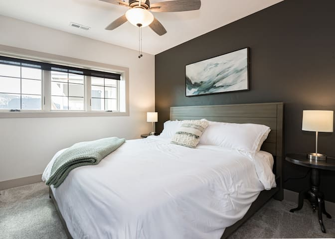 The 3rd king bedroom is located in the walk-out basement, with views to the southeast, and a 1% light filtering roller shade, in case you want to hit the snooze button a few times during your stay.