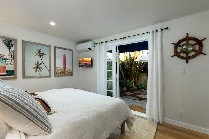 Cozy master bedroom with French Doors that open directly to the lovely backyard! Smart TV packed w/ Netflix and Youtube Live TV. Brand new A/C unit so you sleep at the perfect temperature. Luxury mattress with memory foam pillows