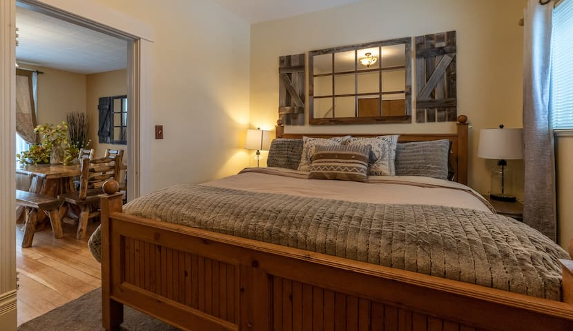 Main floor bedroom!  Enjoy a king size bed with luxurious linens & a TV in the main level bedroom.