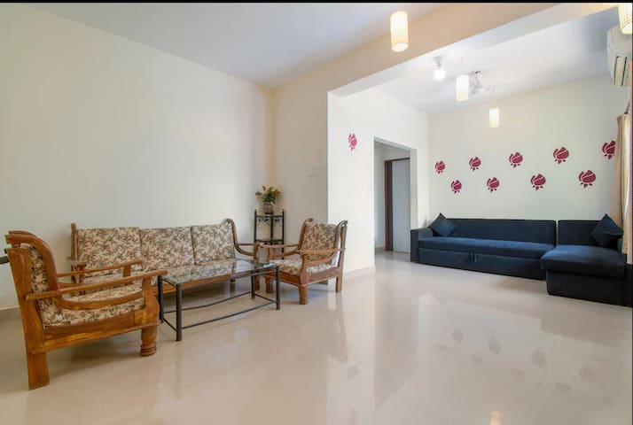 Hall room - furnished with Air-conditioner, 5 seater sofa set with center table, Dining Table with chairs, 4 seater corner sofa-bed and LED TV with Satellite Live